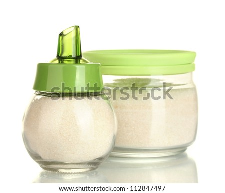 sugar bowl and jar with crystal sugar isolated on white background close-up