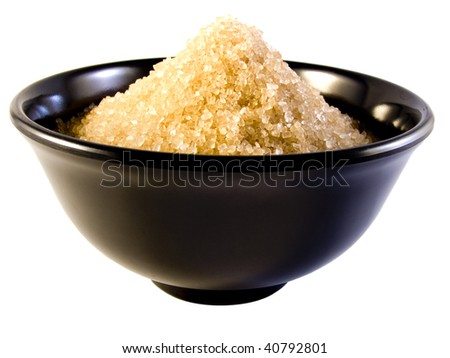 Sugar Bowl filled with brown sugar shot on a white background
