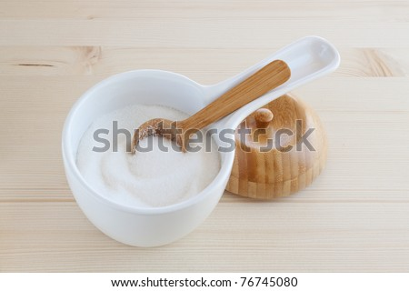 Sugar bowl with a wooden spoon and lid
