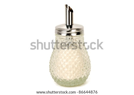 sugar bowl with sugar on a white background