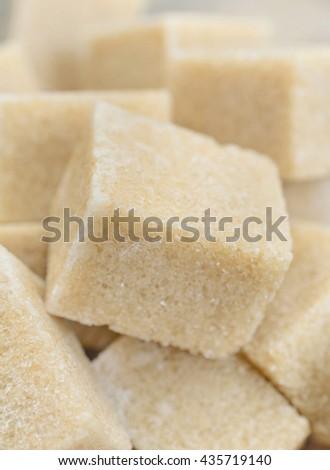 Sugar brown cubes on background closeup