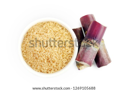 sugar cane piece cut and sugar, granulated sugar brown in a white cup, granulated sugar top view and sugarcane fresh isolated on white background