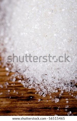 sugar closeup on wooden background
