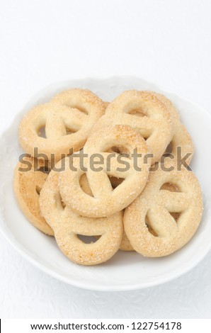 sugar cookies in a white bowl on a white background