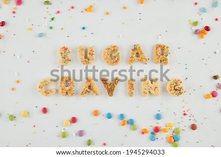 Sugar craving inscription made of biscuit letters and decorated with rainbow sprinkles Photo stock ©