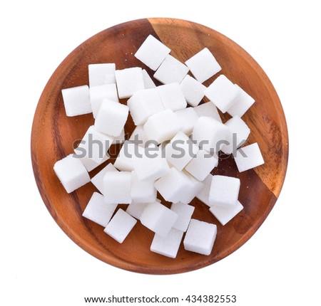 Sugar cube in wood plate #434382553
