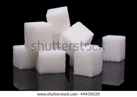 sugar cubes on a reflective surface