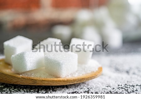 sugar cubes on black backround. Sugar is unhealthy nutrition and leads to obesity, diabetes, dental care ストックフォト ©