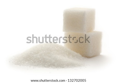 Sugar cubes on white background - stock photo