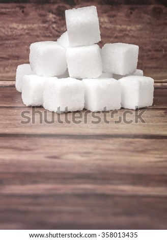 Sugar cubes over wooden background #358013435
