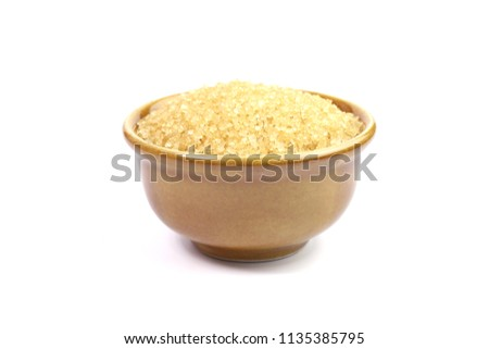 sugar, granulated sugar in ceramic cup brown on white background, granulated sugar cane for ingredient sweet food, brown sugar