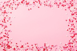 Sugar hearts frame on pink background. Romantic, St Valentines day concept. Top view. Copy space.
