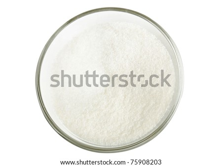 Sugar in a glass bowl isolated on the white