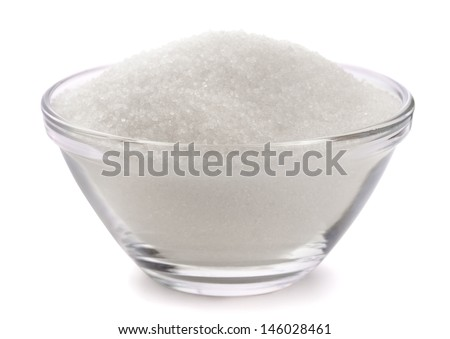 Sugar in glass bowl isolated on white