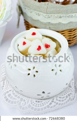 Sugar in shape of heart in white sugar bowl