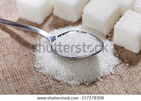 Sugar Is In The Spoon On The Table