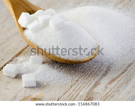 Sugar on wooden table selective focus