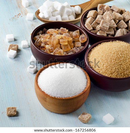 Sugar on wooden table. Selective focus #167256806