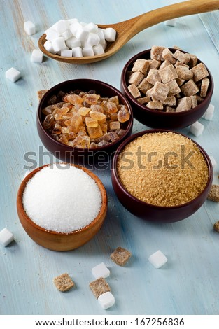 Sugar on wooden table. Selective focus #167256836