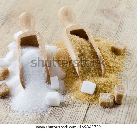 Sugar on wooden table. Selective focus #169863752