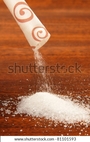 Sugar packet on a wooden table