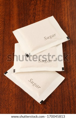 Sugar packet on the wooden table