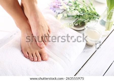 Sugar paste, care of female legs. Beautiful feet of a woman during treatments. #263555975