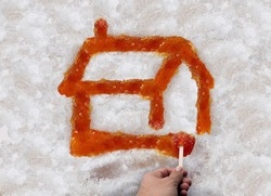 Sugar Shack Maple Syrup and taffy or sweet boiled tree sap on snow as a traditional spring season food culture from Quebec Ontario Canada and New England made in country shacks.