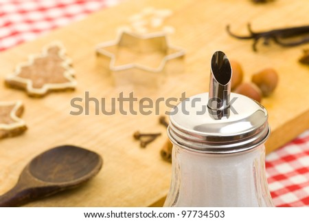 Sugar shaker and christmas cookies with different ingredients