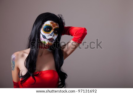 Sugar skull girl in red dress, copy-space for your text