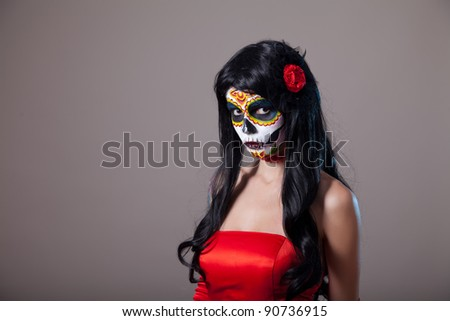 Sugar skull girl in red dress, studio shot - stock photo