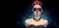 Sugar skull makeup. Halloween party, traditional Mexican carnival, Santa Muerte. Beautiful young woman costume, painted face.