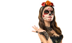 Sugar skull makeup. Halloween party, traditional Mexican carnival, Santa Muerte. Beautiful young woman costume, painted face. Isolated on white background