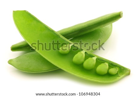 sugar snaps with one opened pod with peas visible on a white background