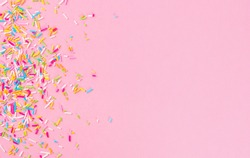Sugar sprinkle dots, decoration for cake and bakery, as a pink easter background.