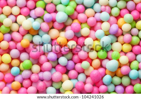 Sugar sprinkle dots, decoration for confectionery. High magnification macro.