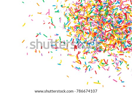Sugar sprinkle dots hearts, decoration for cake and bakery, as a background. Isolated on white.