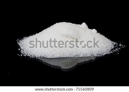 Sugar white sand on a black background