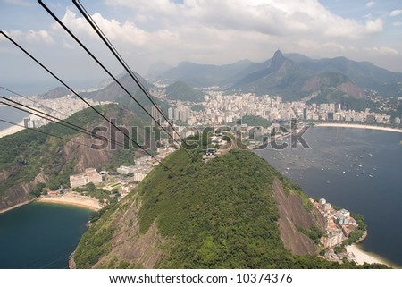 Sugarloaf Mountain and cable car viewed from Botafogo beach - stock photo