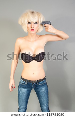 Suicidal girl with a gun - stock photo
