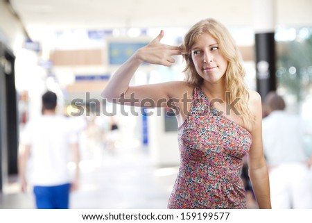 suicide gesture young woman in a shopping center