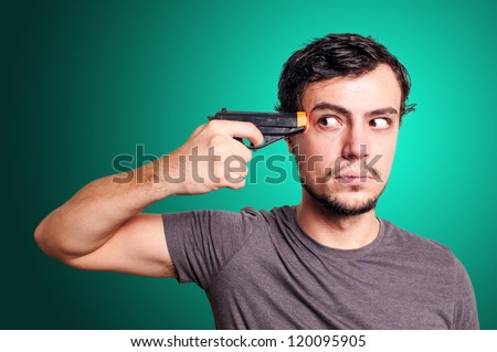 suicide guy with gun on blue background - stock photo