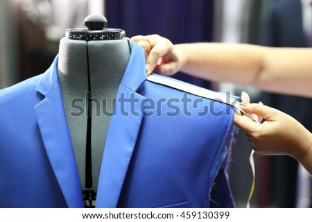 Suit male, sewing measuring. The production plant, sewing jackets for seamstress