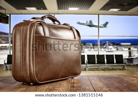 Suitcase and summer travel time. Airport background with plane and free space for your decoration.  #1381515146