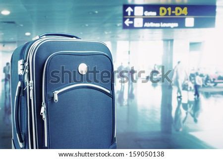 Suitcase at the airport. Toned