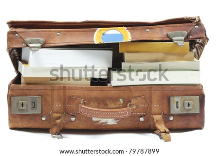 Suitcase filled with books for vacation or study