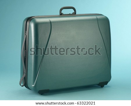 suitcase isolated on a blue background #63322021