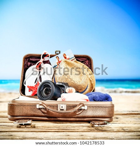 Suitcase of brown color and summer time. Free space for your decoration.  - Shutterstock ID 1042178533