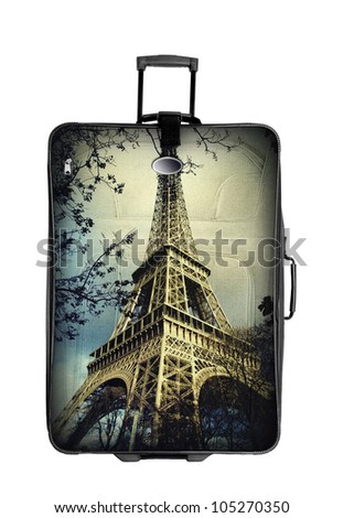 suitcase with eiffel tower photo  isolated over white background