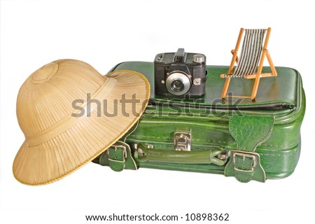 Suitcase with safari hat, old camera and little deck chair - isolated on white background